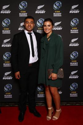 Super Rugby player of the year Richie Mo'unga and fiancee Sophie Vieceli pose on the red carpet.