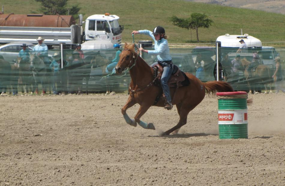 Kaylee Hood, of Christchurch, picks up speed during the junior barrel race.