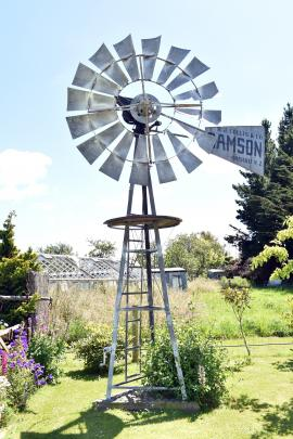 A restored windmill sits prominently in the front lawn.
