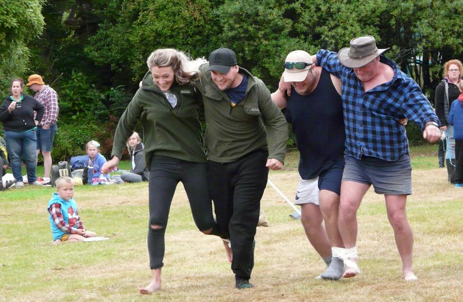 . Taking part in the three-legged race at the Papatowai Beach Carnival on New Year's Eve were (from left) Brittney Stewart and Izzy Maines of Perth, and Nick Stewart and father Stephen, of Invercargill. PHOTO: RICHARD DAVISON