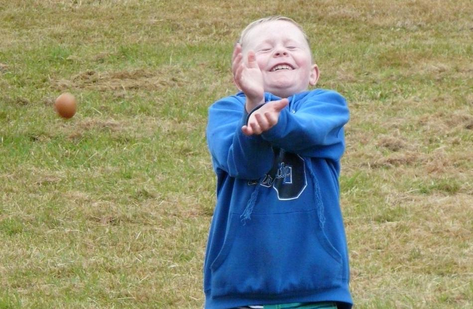 Max Cruickshank (7) of Redan, takes the sensible approach in the egg-hurling competition at the...