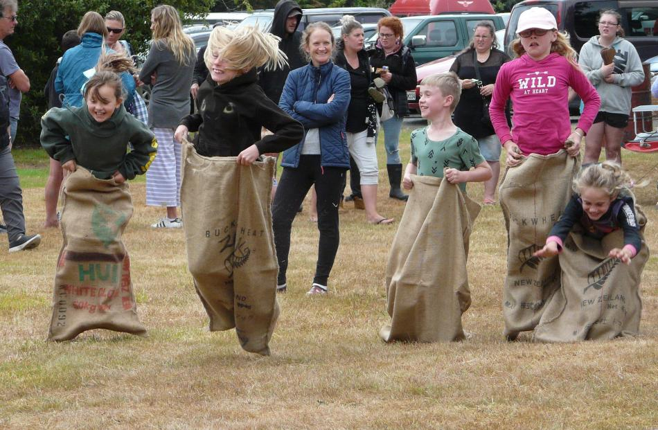 Under-12 participants in the sack race during the Papatowai Beach Carnival on New Year's Eve....