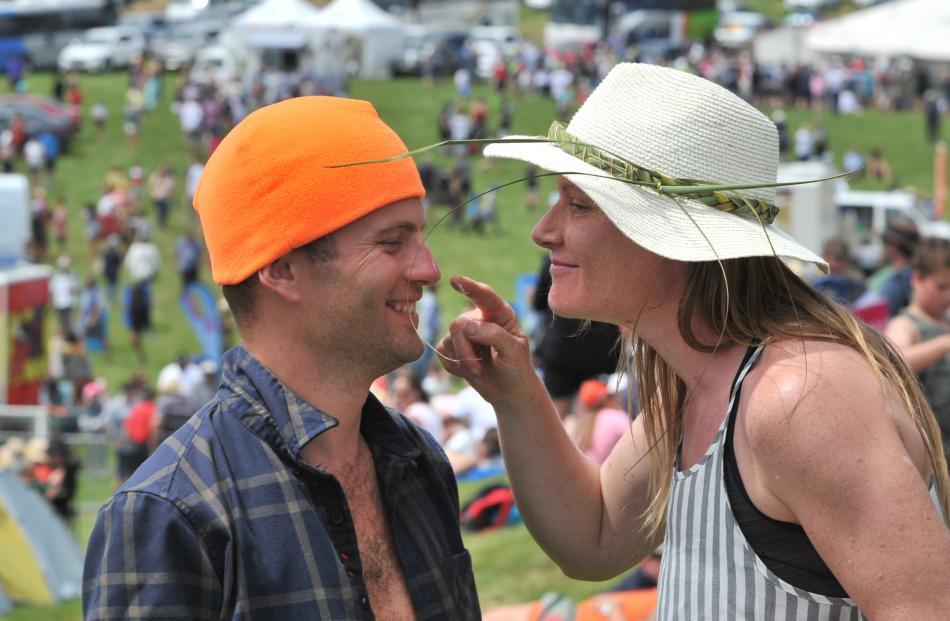 Katrina Shephard puts sunscreen on partner Alex Gardener's nose.