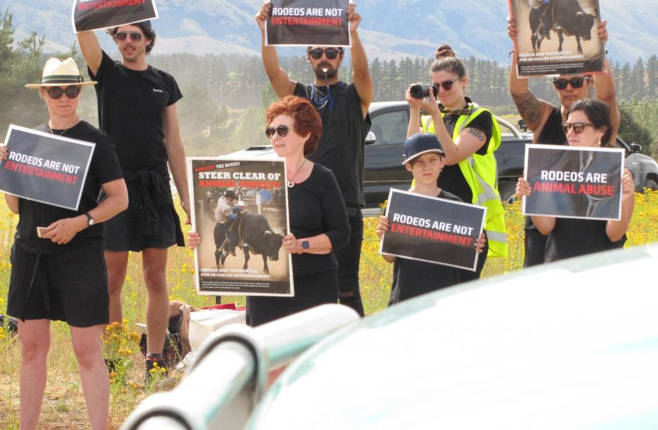 Protesters at the Wanaka Rodeo yesterday make their views clear. Photo: Mark Price
