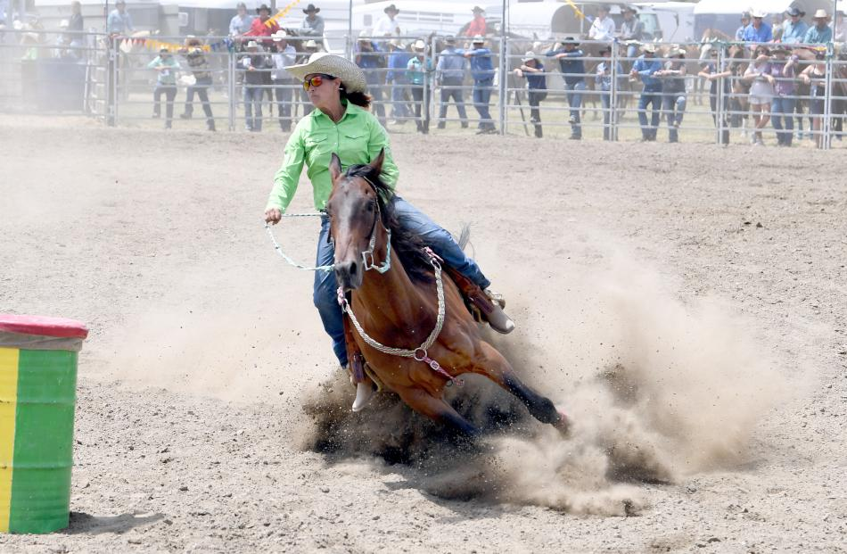 Rhondine Long, Oamaru, rounds the last barrel in the open barrel race to take the title at the...