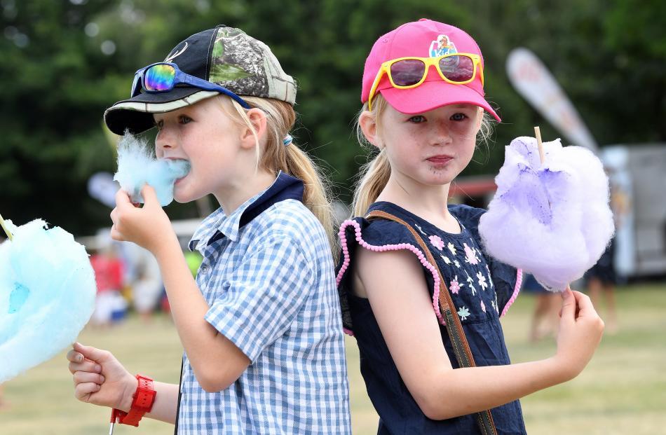 Becks twins Meg and Charlotte Kirk (both 7), enjoying some candy floss.