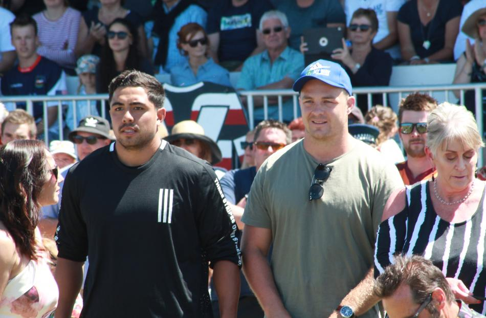All Blacks players (from left) Anton Lienert-Brown and Sam Kane watch on from the sidelines.