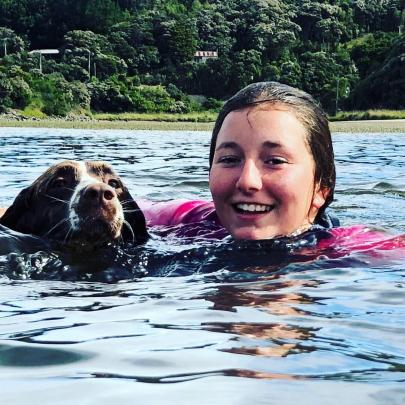 Ella Weatherall (11) and Bessie the dog swim at Taieri Mouth. Photo: Mark Weatherall