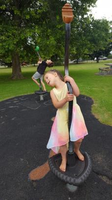 Lewis (7) and Libby (4) Maclennan give it a whirl at the Mosgiel Memorial Gardens playground....