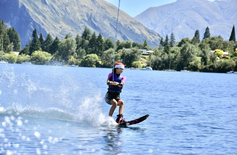 A very happy and festive Maya Brockie (14) has fun waterskiing on Christmas Eve, while visiting...