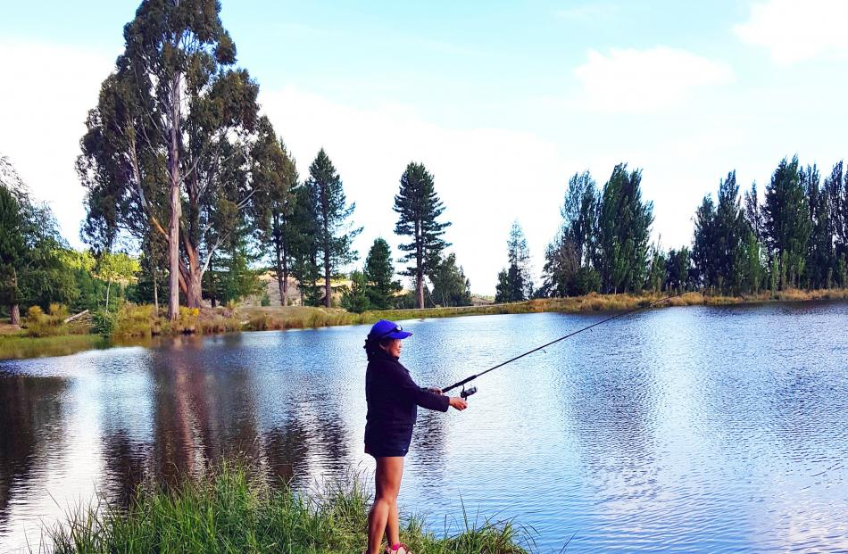 Gerry Hunter tries her hand at fishing for the first time at Coalpit Dam in Naseby. Photo: Rob Hunter