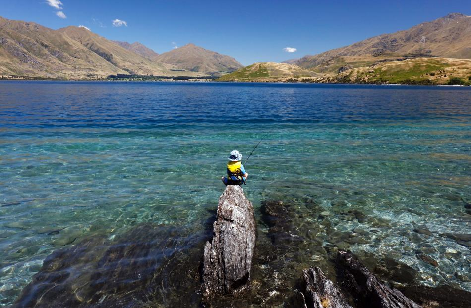 Flynn Trickey (7), of Dunedin, fishes on his own for the first time, at Lake Wanaka last week. Photo: Jared Mason