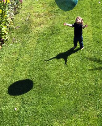 Emile Sinclair (2) plays with a ball in his grandparents' garden. Photo: Jacqueline Sinclair