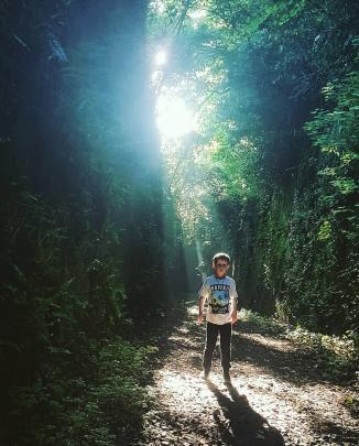 Fletcher La Roche (9) enjoys the rays of light in the otherwise dark Caversham tunnel entrance. Photo: Alex La Roche