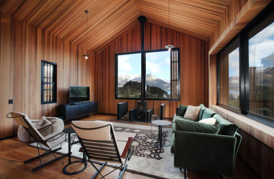 The comfortable living area boasts lake and mountain views.