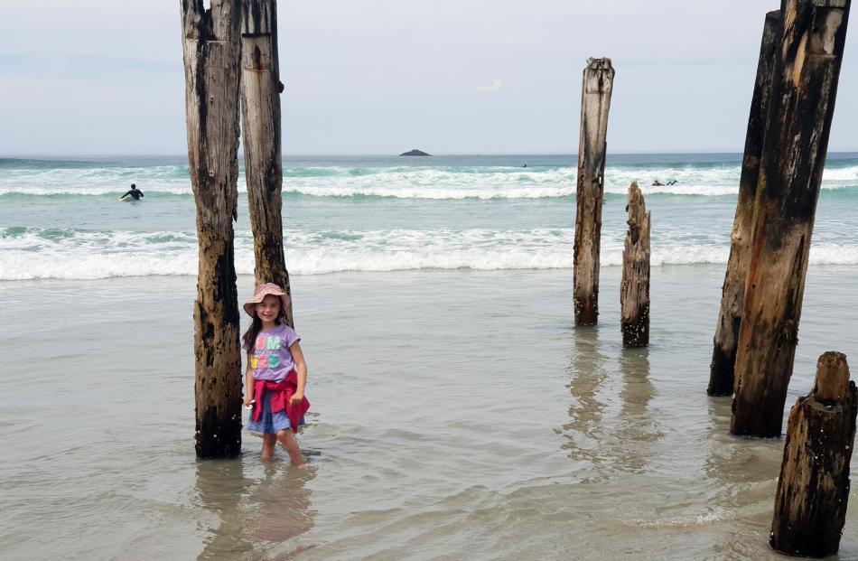 Charlotte Morgan (6) cools her feet at St Clair Beach. Photo: Marie Bouman