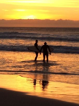 Michael Jopson and Casey Munro on St Clair Beach, catching the sunrise and looking for waves. Jan...