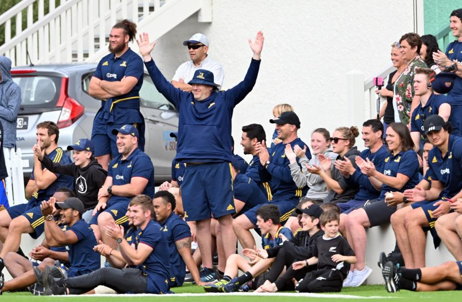 Highlanders assistant coach Glenn Delaney (centre) leads the cheers on the sideline for his team.