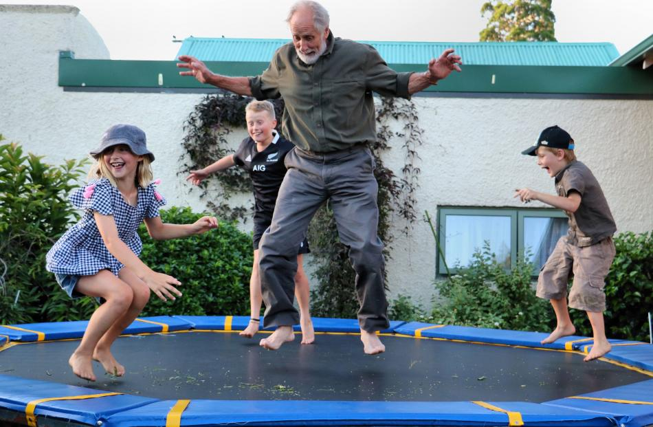Ronald Clark jumps on a trampoline with grandchildren (from left) Sienna Clark (8), of Wanaka,...