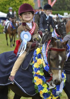 Brin Millar (6), of Outram, beams atop pony Silverbank Melemisa, having won almost more prizes...