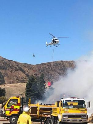 Two helicopters have been sent to help battle a large blaze in Broken Hut Rd, south of Omarama this afternoon. Photo: Heliventures NZ Ltd via Facebook