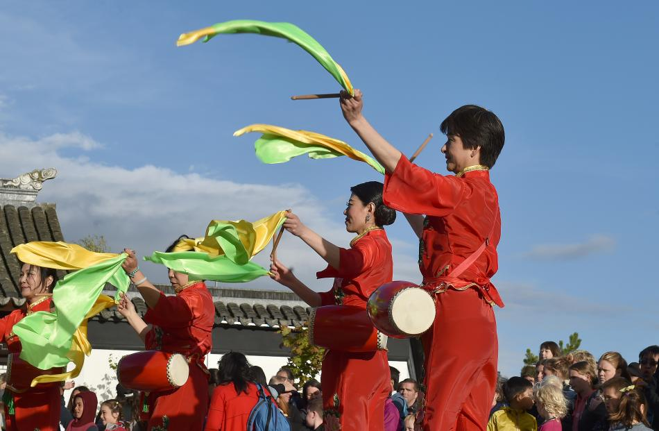 Costumed performers entertain the crowd, marking the start of the Year of the Pig.