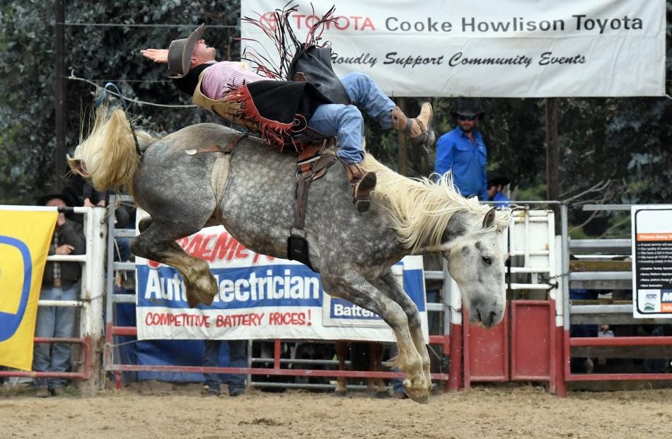 Tate Macdonald, Athol, competes in the open saddle bronc.