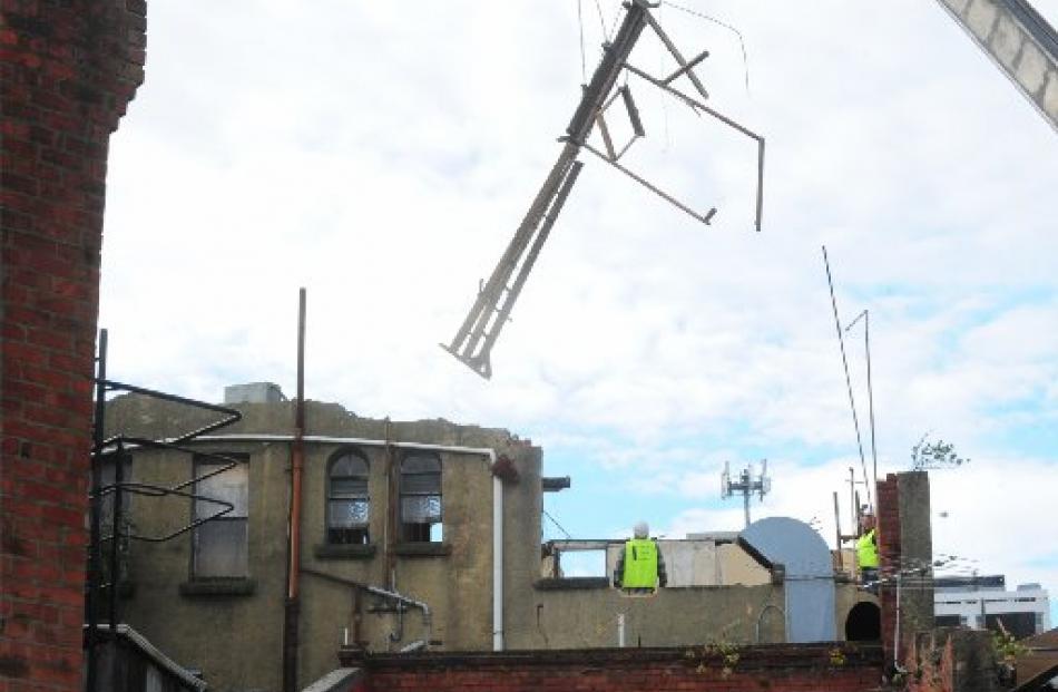Demolition work gets under way. Photo by Craig Baxter