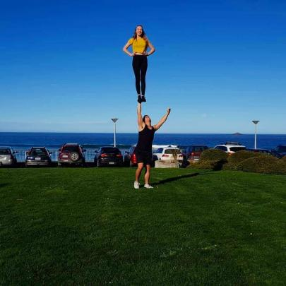Coaches: Graham and Bobby partner stunting at St Clair beach.