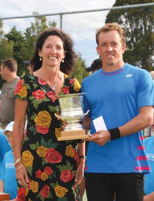 Julie Paterson of Auckland (ex Te Anau) CEO Tennis New Zealand presenting the Willans Trophy to...