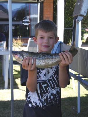 Six-year-old Eddie Barnes of Te Anau holding his rainbow trout after weigh-in at the Te Anau Club...