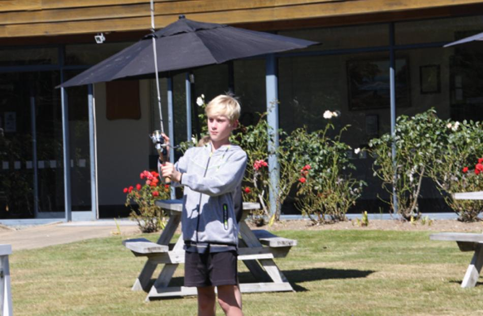 11 year old  Ollie Dockerty of Christchurch, tries his hand at the Fly and Spin Casting...