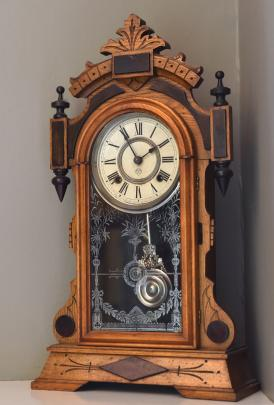 A hand-curved, turn-of-the-century Ansonia clock keeps perfect time.