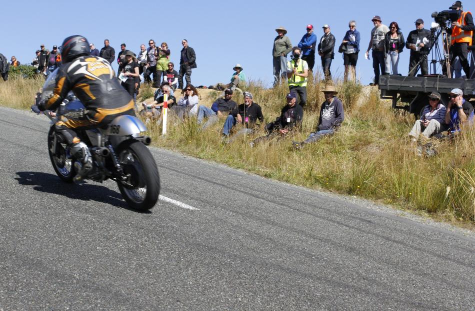 Spectators watch as Butch Woods from Alexandra motors his 1970 Norton Commando 750 up the first...
