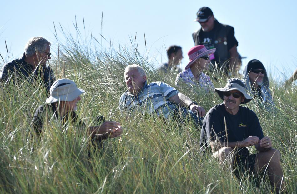 Onlookers relax in the sand dunes to watch the racing.
