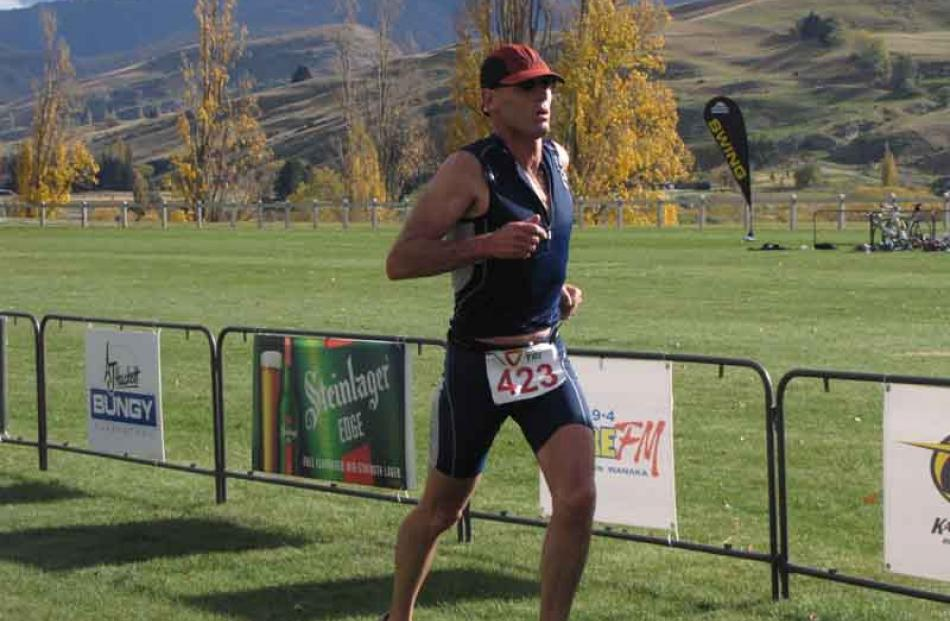 Mark Cockroft, of Wanaka, about to finish second in the Triathlon Swim Veteran Male category.