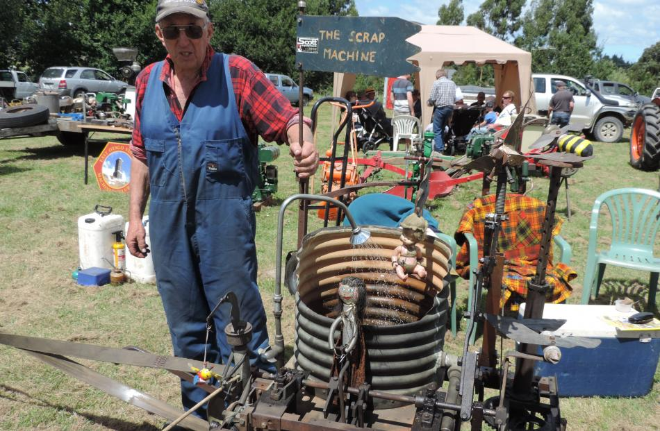 "Brian Smith, of Winchester, intrigued the crowd with his ""scrap machine'' powered by a pump made from a Stirling hot air engine."