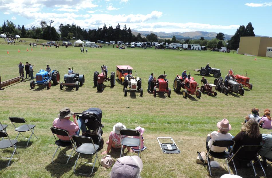 Tractors from decades past took part in the East Otago Show's grand parade.