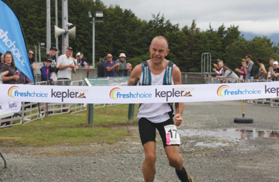 Fiordland Athletics Club Captain and Te Anau police officer Dwight Grieve shows his emotion as he...