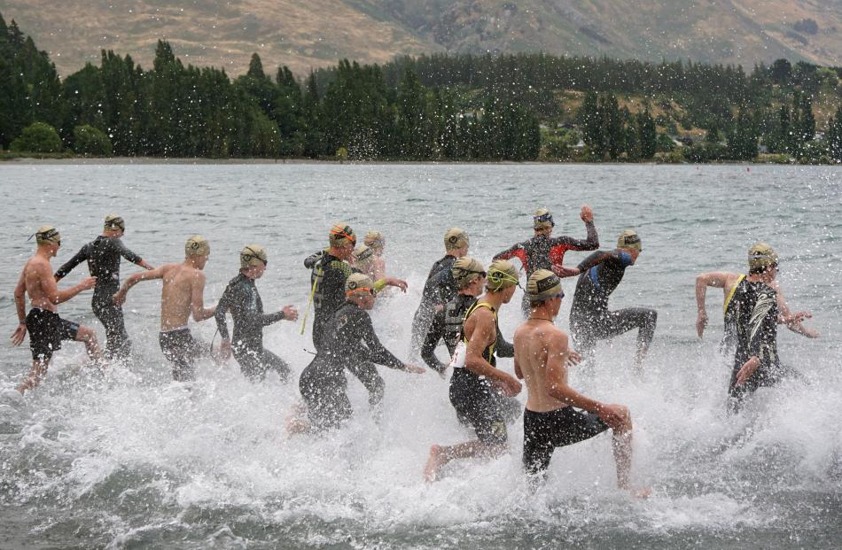 Entering the water are the competitors in the under-16 boys race. Photos: Sean Nugent
