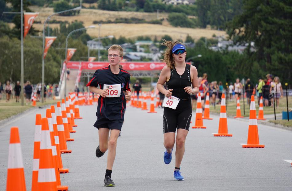 Hitting the mark simultaneously are Hamish Mills (left), of South Otago High School, and Natalie...