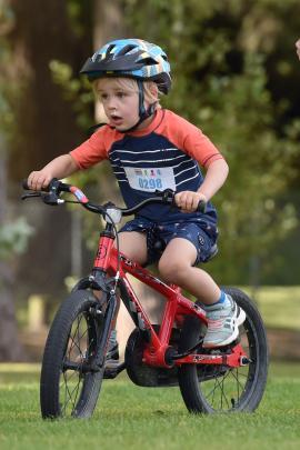 Harry Hall (4) powers his bike through the grass.