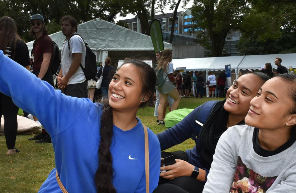 Biomedical sciences student Mee Hwa Atimalala (20, left), of Samoa, takes a selfie with health...
