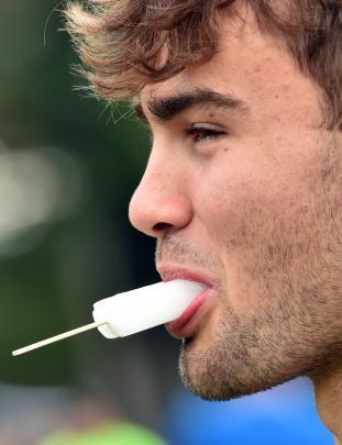 University student Liam Collett enjoys an ice block.