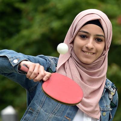 Student Tabarak Barham blocks back a table tennis ball. PHOTO: PETER MCINTOSH