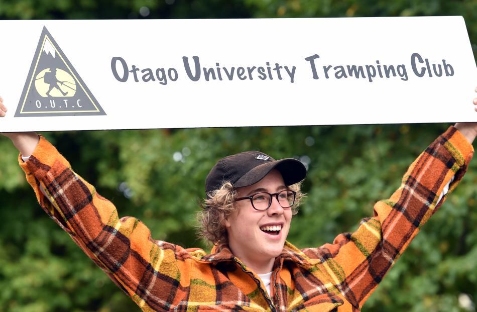 Otago University Tramping Club member Cameron Wright advertises at the Otago University Students'...