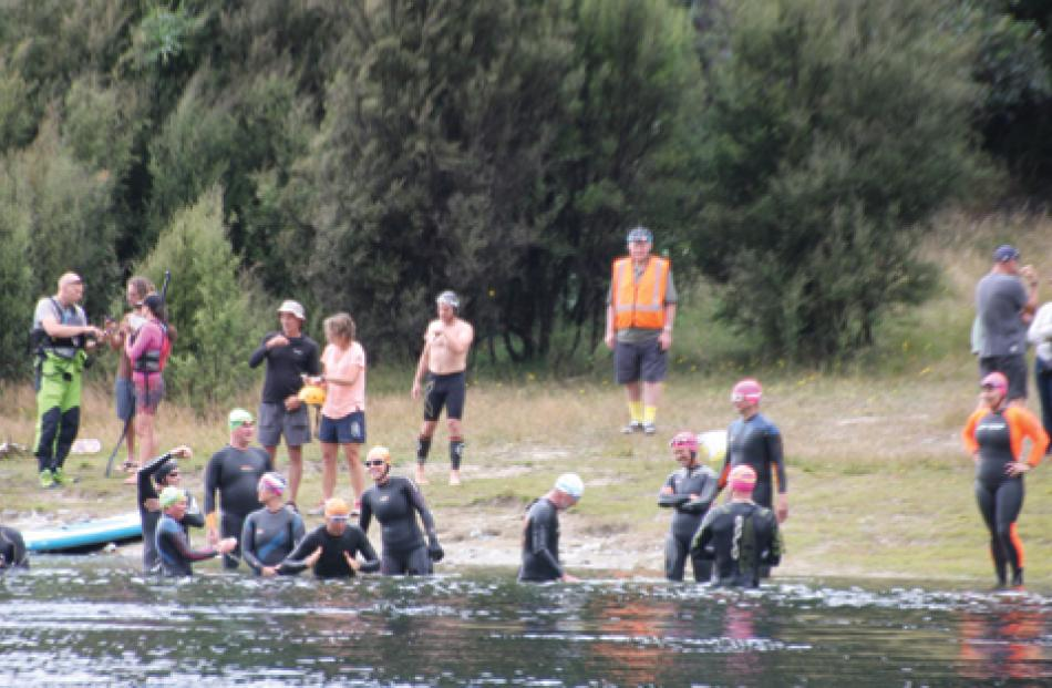 Swimmers entering the water in the Upper Waiau River at the Control Gates in Te Anau for the...