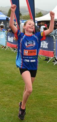 Jessie Roff (9), of Mosgiel, crosses the finish line.