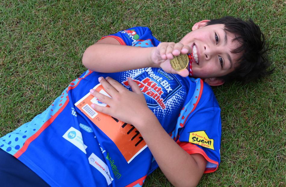 Ty Murphy (9), of Dunedin, admires his medal.