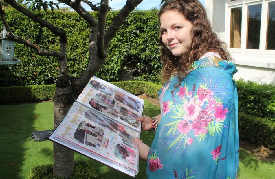 Zoe Dawson shows her scrapbook of memories from Kenya. PHOTO: LUISA GIRAO